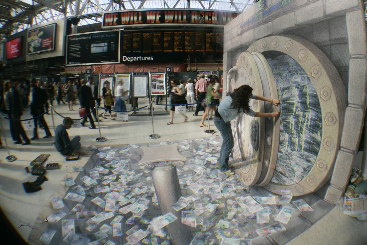 A woman poses in U.S. street artist Kurt Wenner's 3D illustration of an open vault containing British currency, fluttering out at Waterloo station, London, July 24, 2008. (AP Photo/Sang Tan)