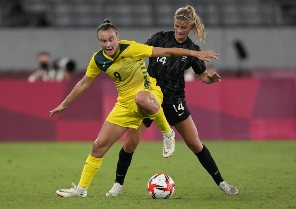 Australia's Caitlin Foord, left, and New Zealand's Katie Bowen battle for the ball during a women's soccer match at the 2020 Summer Olympics, Wednesday, July 21, 2021, in Tokyo. (AP Photo/Ricardo Mazalan)