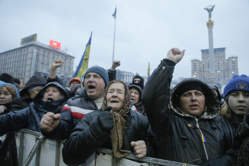 People raise their fists during a rally in Independence Square, the epicenter of the country's current unrest, in Kiev, Ukraine, Saturday, Feb. 22, 2014. Protesters in the Ukrainian capital claimed full control of the city Saturday following the signing of a Western-brokered peace deal aimed at ending the nation's three-month political crisis. The nation's embattled president, Viktor Yanukovych, reportedly had fled the capital for his support base in Ukraine's Russia-leaning east. (AP Photo/Efrem Lukatsky)