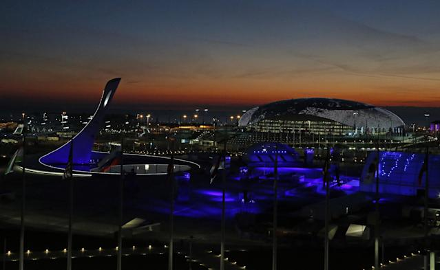 The sun sets over the Olympic Park before the opening ceremony of the 2014 Winter Olympics in Sochi, Russia, Friday, Feb. 7, 2014. (AP Photo/Julio Cortez)