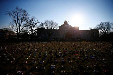 Activists install 7000 shoes on the lawn in front of the U.S. Capitol on Capitol Hill in Washington, U.S. March 13, 2018.  REUTERS/Eric Thayer