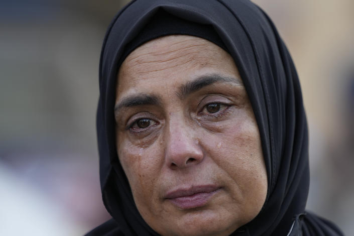 Ilham al-Bikai, mother of Ahmad Kaadan, who died during the Aug. 4, 2020, Beirut port explosion, cries during a protest near the parliament building to demand an expedited investigation, in Beirut, Lebanon, Sunday, July 4, 2021. A year after the deadly blast, families of the victims are consumed with winning justice for their loved ones and punishing Lebanon's political elite, blamed for causing the disaster through their corruption and neglect. Critics say the political leadership has succeeded so far in stonewalling the judicial investigation into the explosion. (AP Photo/Hassan Ammar)