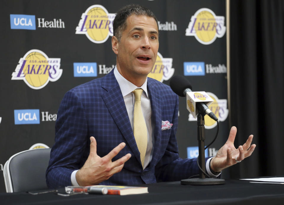 """<a class=""""link rapid-noclick-resp"""" href=""""/nba/teams/lal"""" data-ylk=""""slk:Lakers"""">Lakers</a> general manager Rob Pelinka talks about the acquisition of <a class=""""link rapid-noclick-resp"""" href=""""/nba/players/3704/"""" data-ylk=""""slk:LeBron James"""">LeBron James</a> and other free agents at a news conference at the team's headquarters in El Segundo, Calif., on Wednesday. (AP)"""