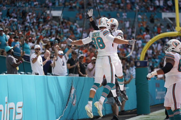 Miami Dolphins tight end Mike Gesicki (88), celebrates scoring a touchdown with teammate Miami Dolphins wide receiver Albert Wilson (2), during the second half of an NFL football game against the Indianapolis Colts, Sunday, Oct. 3, 2021, in Miami Gardens, Fla. (AP Photo/Lynne Sladky)