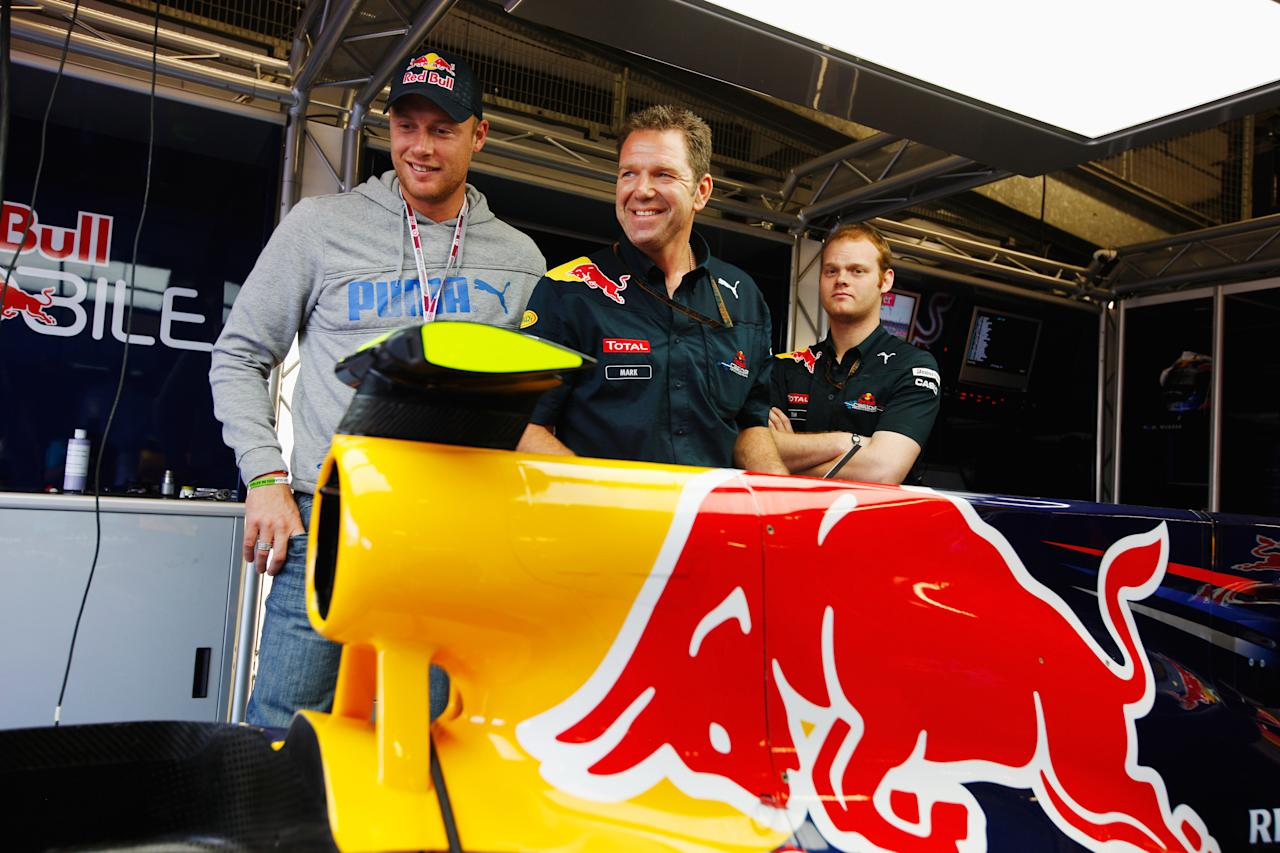 NORTHAMPTON, UNITED KINGDOM - JULY 11:  Cricketer Andrew Flintoff visits the Red Bull Racing garage before the British Formula One Grand Prix at Silverstone on June 11, 2010, in Northampton, England.  (Photo by Mark Thompson/Getty Images) *** Local Caption *** Andrew Flintoff