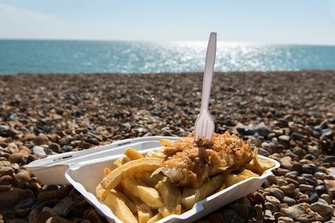 Brighton beach: a still life of pebbles, fish and chips - Credit: ©pitr134 - stock.adobe.com/Peter Kollar