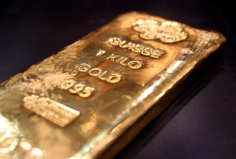 FILE PHOTO: One kilo gold bar is displayed in shop in Dubai's gold souk