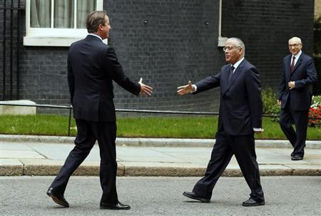 Britain's Prime Minister David Cameron greets his Libyan counterpart Ali Zeidan at Number 10 Downing Street in London