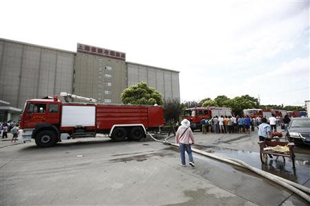 Fire trucks are seen outside a refrigeration unit of Shanghai Weng's Cold Storage Industrial Co. Ltd. in the Baoshan district of Shanghai August 31, 2013. REUTERS/Aly Song