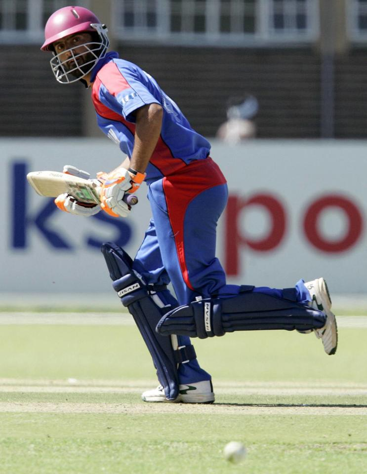 PRETORIA, SOUTH AFRICA - APRIL 13:  Nawroz Mangal of Afghanistan scores some runs during the ICC Mens Cricket World Cup qualifier match between Canada and Afghanistan from LC de Villiers Oval on April 13, 2009 in Pretoria, South Africa.  (Photo by Dominic Barnardt/Gallo Images/Getty Images)