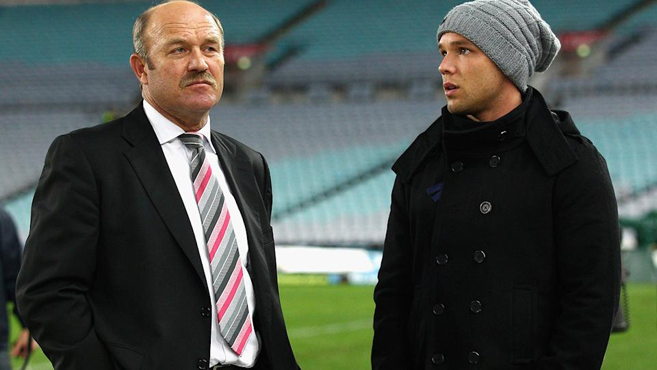 Wally Lewis, pictured here with son Lincoln during the State of Origin series in 2011.