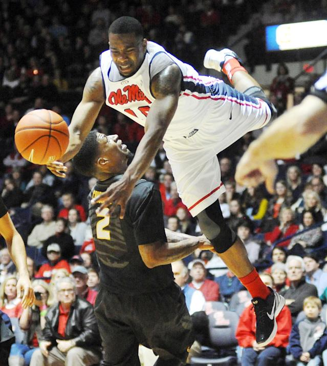 Mississippi's LaDarius White, top, is fouled by Missouri's Tony Criswell (2) during an NCAA college basketball game in Oxford, Miss. on Saturday, Feb. 8, 2014. (AP Photo/The Oxford Eagle, Bruce Newman)
