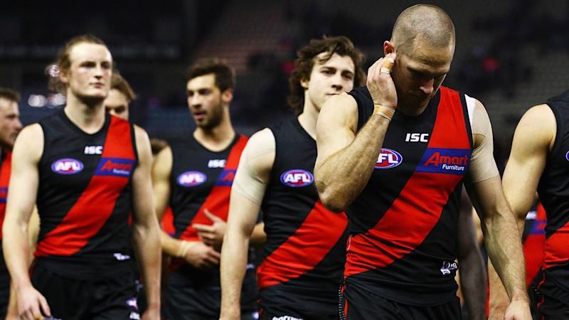 The Bombers look dejected following their 104-point drubbing at the hands of the Western Bulldogs. (Photo by Graham Denholm/Getty Images)
