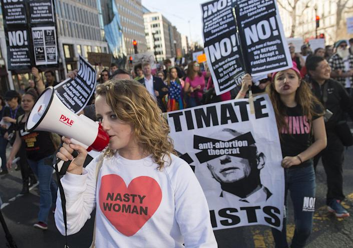 """<p>Demonstrators march from Dupont Circle to the White House during a """"Not My President's Day"""" protest against President Trump on Presidents' Day in Washington, D.C., Feb. 20, 2017. (Saul Loeb/AFP/Getty Images) </p>"""