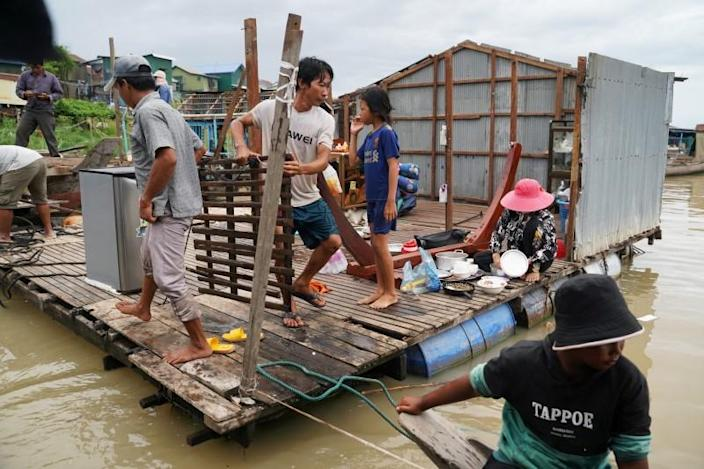 Residents demolish their floating houses on the Tonle Sap river after they were ordered to leave within one week of being notified by local authorities in Prek Pnov district