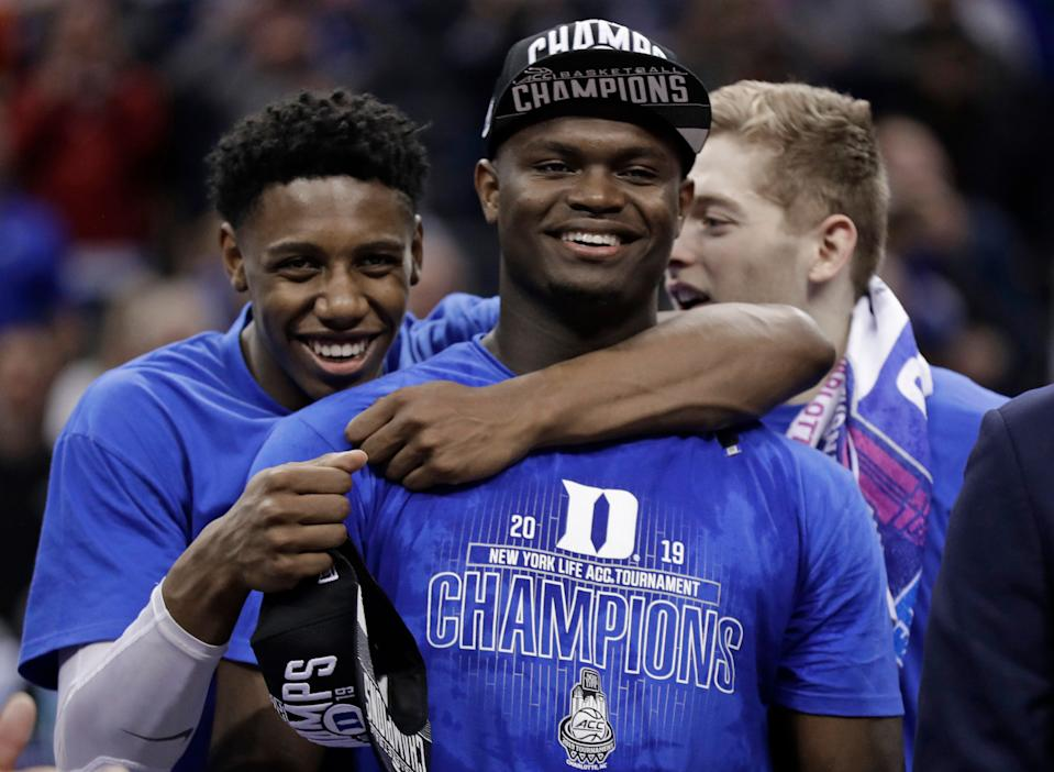 Duke's RJ Barrett, left, hugs Zion Williamson after Duke defeated Florida State in the NCAA college basketball championship game of the Atlantic Coast Conference tournament in Charlotte, N.C., Saturday, March 16, 2019. (AP Photo/Chuck Burton)