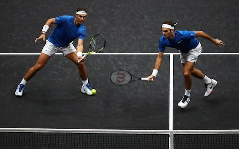 <span>Roger Federer and Rafa Nadal almost go for the same ball</span> <span>Credit: GETTY IMAGES </span>