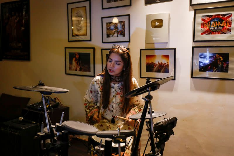 Dananeer Mobeen, a social media influencer who has become famous after her five-second video went viral, plays the drums during an interview with Reuters, in Karachi, Pakistan
