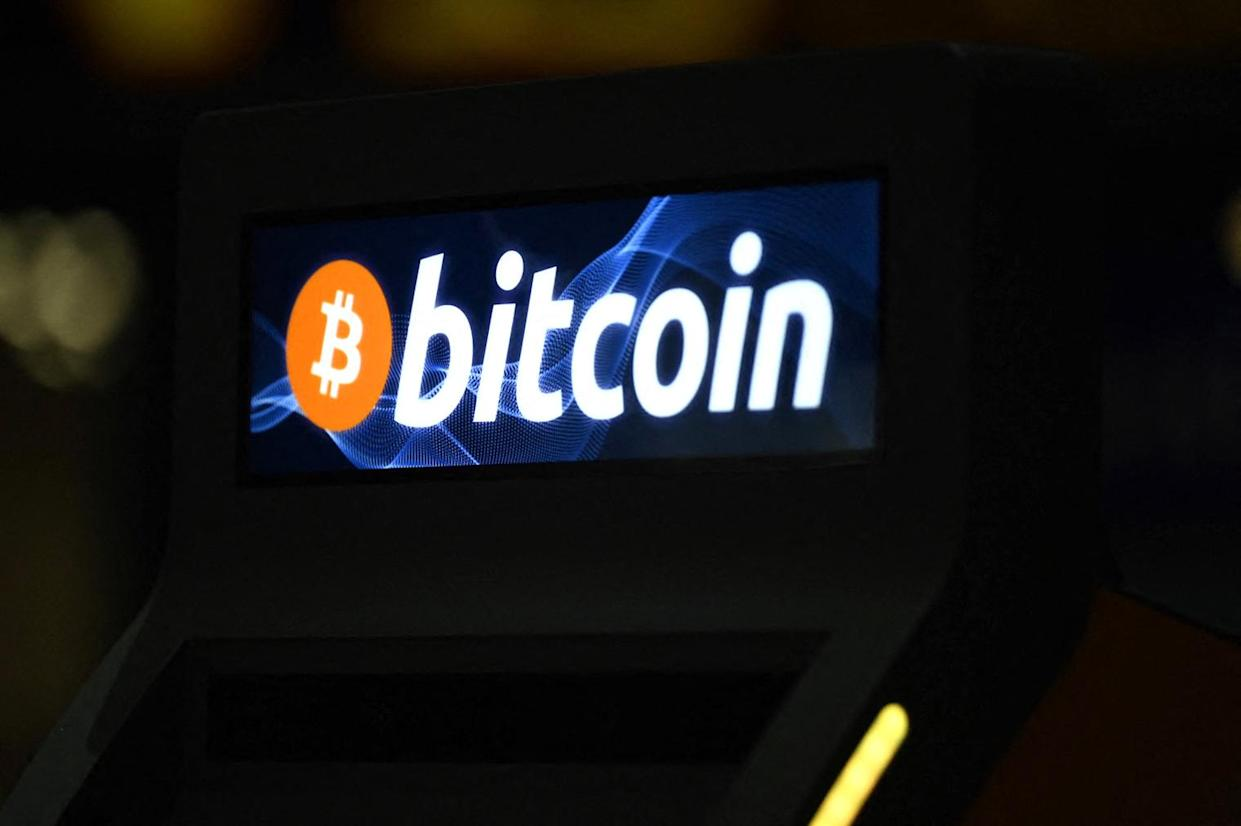 A Bitcoin sign on a Bitcoin ATM, after its inauguration by Athena Bitcoin Inc at a shopping mall in San Salvador, on June 24, 2021. The Bitcoin is an official currency in El Salvador