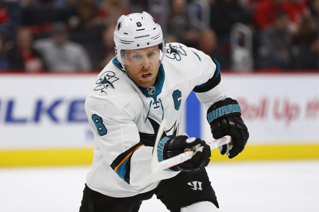 FILE - In this Feb. 24, 2019, file photo, San Jose Sharks center Joe Pavelski skates against the Detroit Red Wings during the third period of an NHL hockey game in Detroit. Pavelski joined the Dallas Stars as an expensive free agent coming off one of his best goal-scoring years, while Corey Perry quietly signed a low-cost one-year contract after playing the fewest games of his career because of a knee injury. That's where the differences end for a pair of veterans trying to help the Stars make back-to-back playoff trips for the first time in more than a decade. (AP Photo/Paul Sancya, File)