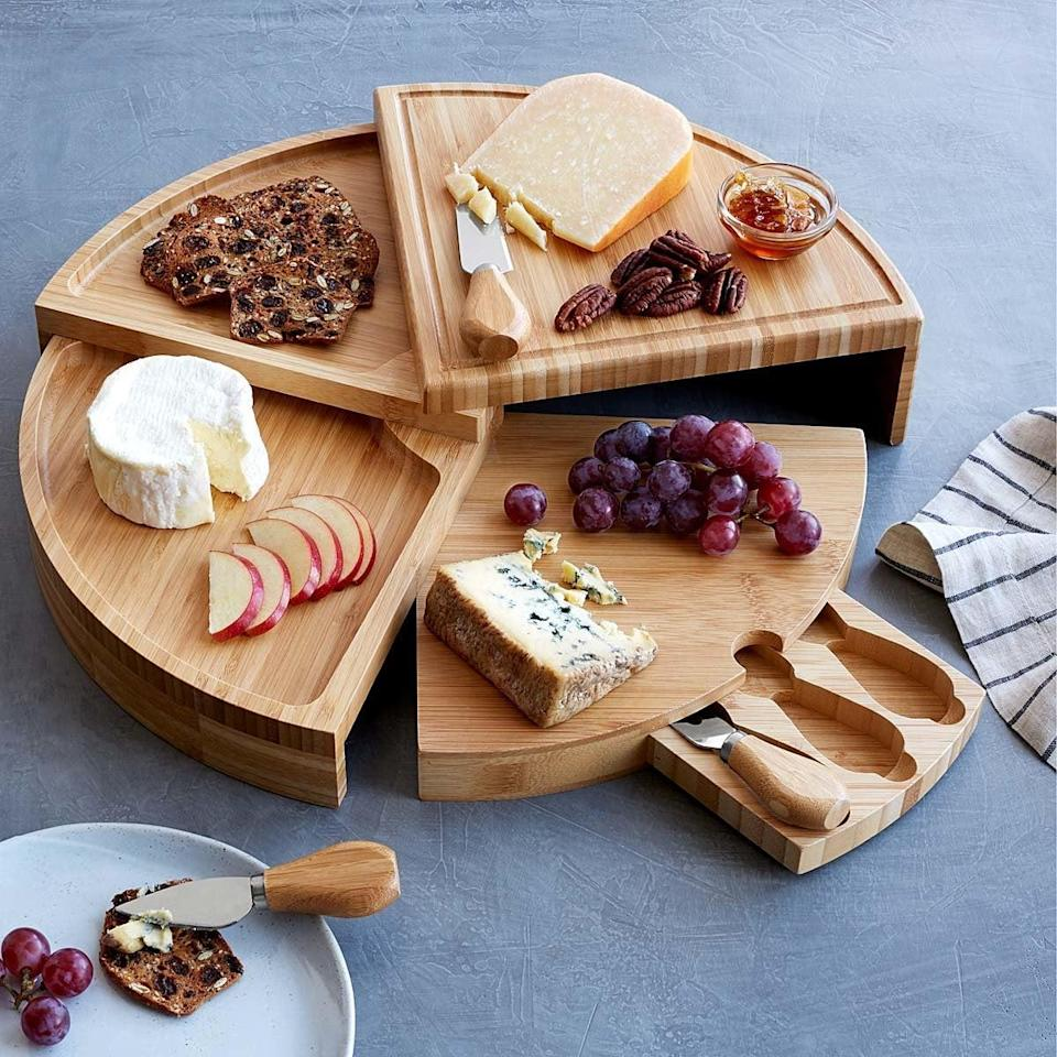 <p>Gift the ultimate hostess this <span>Compact Swivel Cheese Board with Knives</span> ($42).</p>