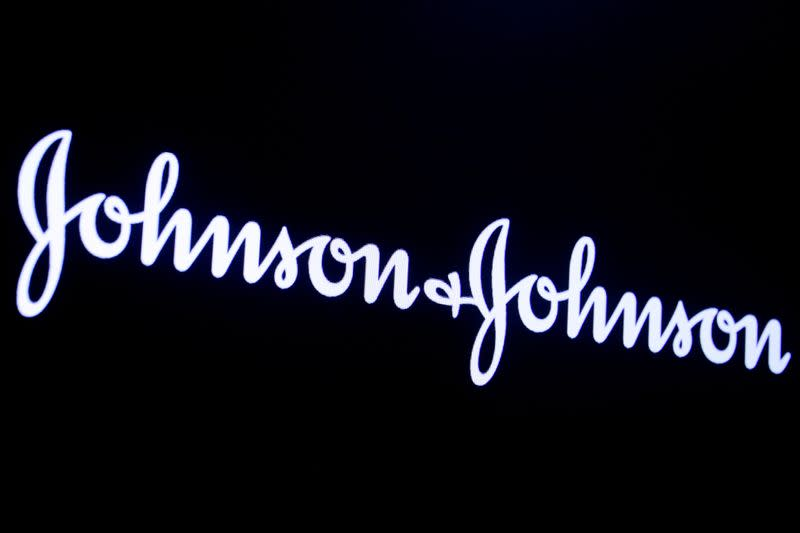 The company logo for Johnson & Johnson is displayed on a screen to celebrate the 75th anniversary of the company's listing at the NYSE in New York