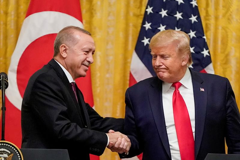 U.S. President Donald Trump greets Turkish President Recep Tayyip Erdogan during a joint news conference at the White House in Washington on Nov. 13. (Photo: Joshua Roberts/Reuters)