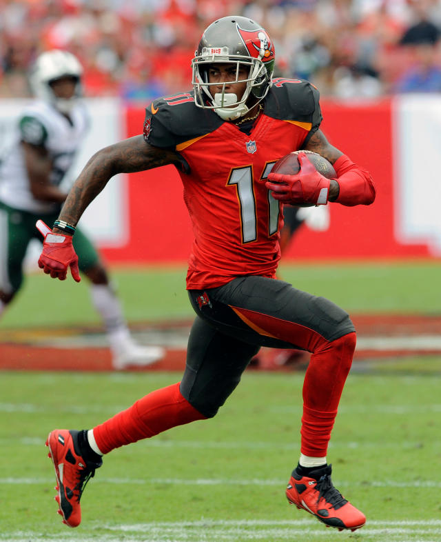 FILE - In this Nov. 12, 2017, file photo, Tampa Bay Buccaneers wide receiver DeSean Jackson (11) runs with a reception against the New York Jets during the first half of an NFL football game, in Tampa, Fla. Buccaneers receiver DeSean Jackson, coming off one of the least productive seasons of his career, is working to improve the chemistry between him and quarterback Jameis Winston. (AP Photo/Steve Nesius, File)