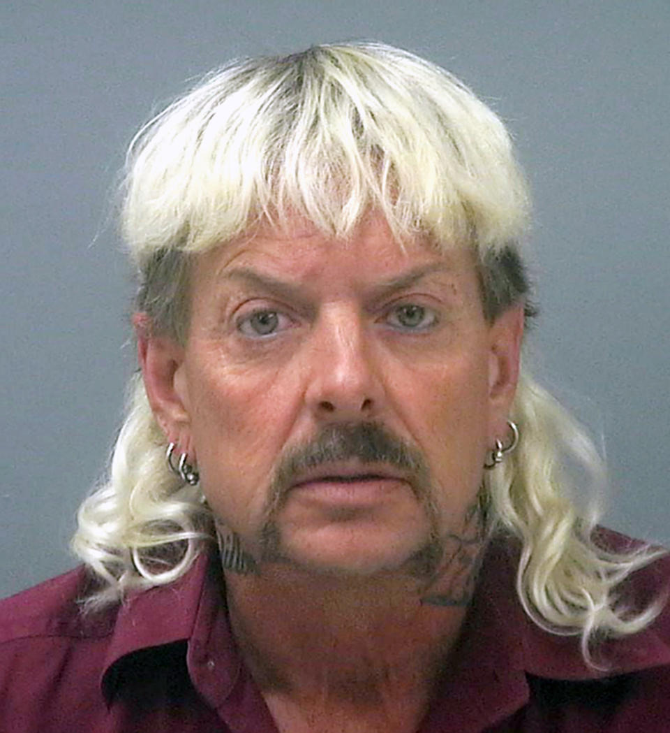 """FILE - This undated file photo provided by the Santa Rose County Jail in Milton, Fla., shows Joseph Maldonado-Passage, also known as Joe Exotic. A federal judge in Oklahoma has awarded ownership of the zoo made famous in Netflix's """"Tiger King"""" docuseries to Joe Exotic's rival, Carole Baskin. In a ruling Monday, June 1, 2020, U.S. District Judge Scott Palk granted control of the Oklahoma zoo that was previously run by Joseph Maldonado-Passage — also known as Joe Exotic — to Big Cat Rescue Corp. (Santa Rosa County Jail via AP, File)"""
