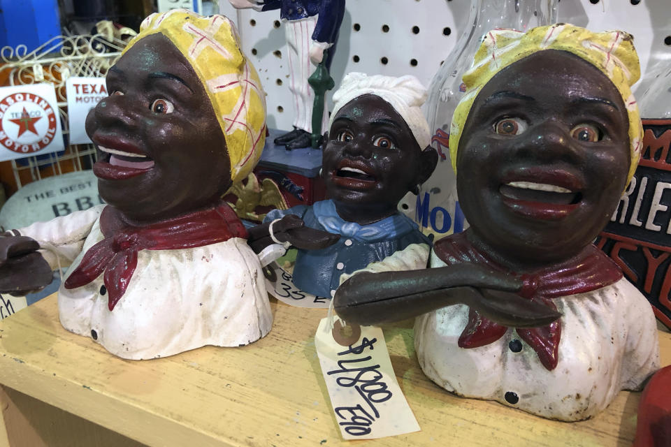 """Cookie jars and other figurines modeled after a """"Mammy"""" image are for sale at the Exit 76 Antique Mall in Edinburgh, Indiana, Tuesday, July 21, 2020. U.S. Rep. Greg Pence is coming under criticism for allowing the sale of objects with racist depictions of African Americans at the sprawling antiques mall he co-owns. (AP Photo/Casey Smith)"""