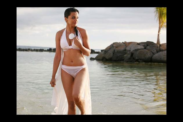 Mugdha Godse sports a white bikini in 'Help', but it did not do much to help the movie from sinking without a trace.