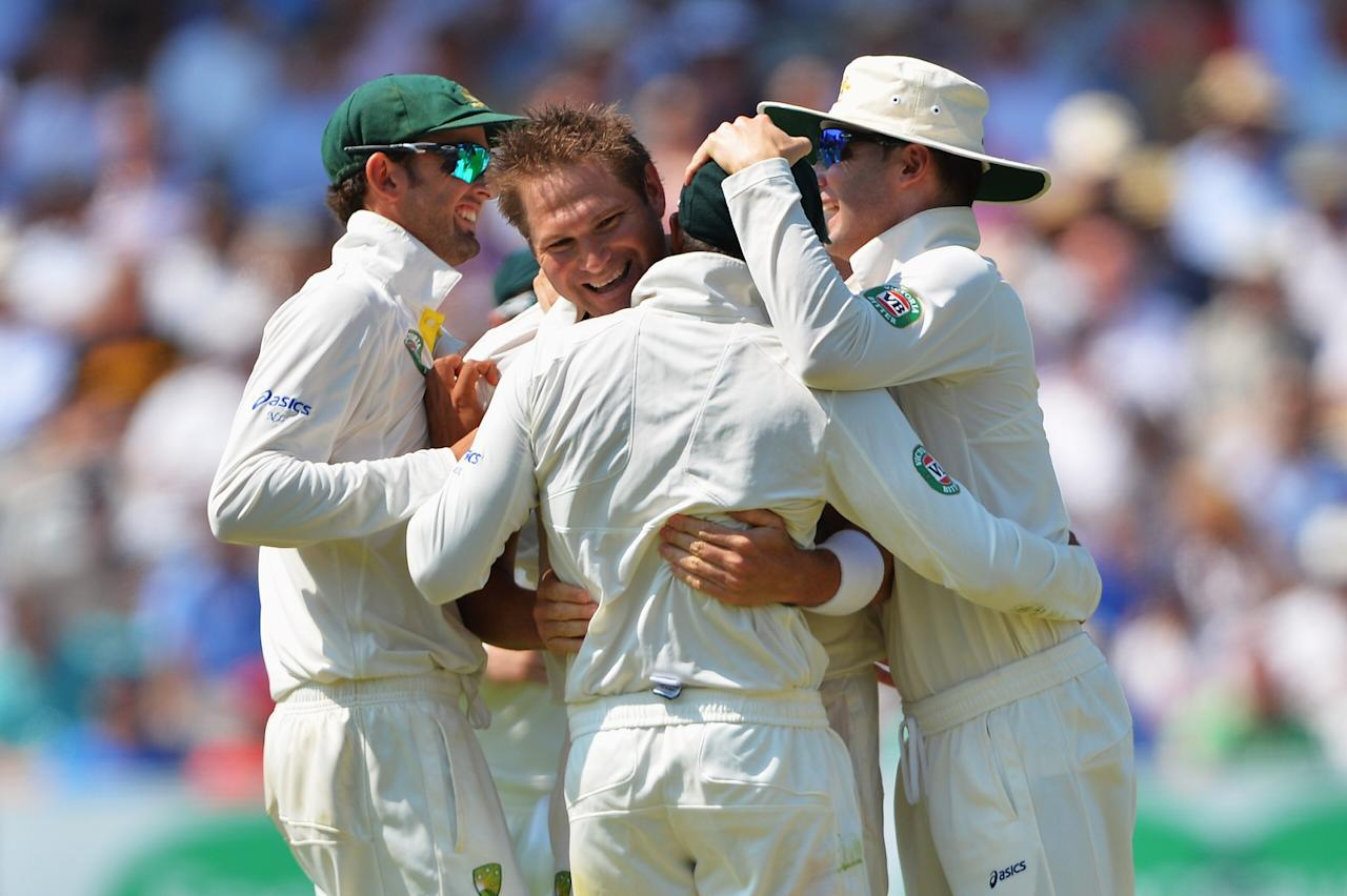 LONDON, ENGLAND - JULY 18: Ryan Harris (2ndL) of Australia celebrates the wicket of Jonathan Trott of England with team mates during day one of the 2nd Investec Ashes Test match between England and Australia at Lord's Cricket Ground on July 18, 2013 in London, England. (Photo by Mike Hewitt/Getty Images)