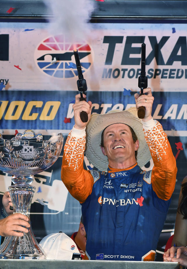 Scott Dixon, of New Zealand, shoots blank in Victory Lane after winning the IndyCar auto race Saturday, June 9, 2018, in Fort Worth, Texas. (AP Photo/Larry Papke)