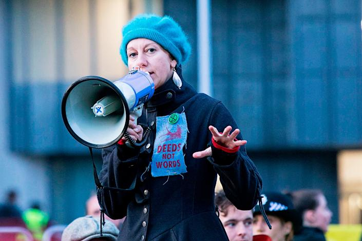 Co-founder Gail Bradbrook speaks to activists blocking a road in Central London on Oct. 9. | George Cracknell Wright—LNP/Shutterstock