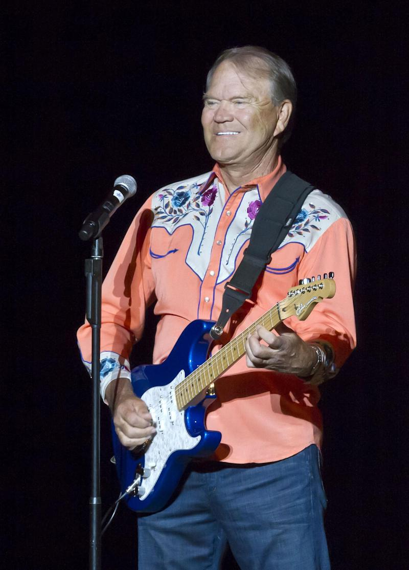 FILE - In this Sept. 6, 2012 file photo, singer Glen Campbell performs during his Goodbye Tour in Little Rock, Ark. Campbell finished off his Goodbye Tour on Friday night, Nov. 30, 2012, in Napa, Calif., but is considering scheduling more dates in 2013. The singer has Alzheimer's disease.  (AP Photo/Danny Johnston, File)