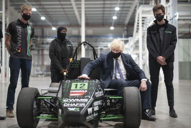 Prime Minister Boris Johnson with an electric car developed by Warwick University engineering students during his visit to the UK Battery Industrialisation Centre in Coventry