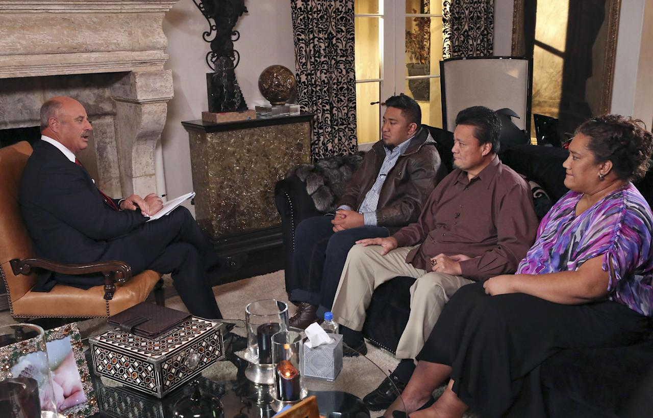 """In this Jan. 24, 2013, photo provided by CBS Television Distribution/Peteski Productions, talk show host Dr. Phil McGraw, left, interviews Ronaiah Tuiasosopo and his parents Titus and Cheannie Tuiasosopo during taping for the """"Dr. Phil Show"""" in Los Angeles. The program, which aired Thursday, Jan. 31, and Friday, Feb. 1, was the first on-air interview of Ronaiah, the man who allegedly concocted the girlfriend hoax that ensnared Notre Dame football star Manti Te'o. (AP Photo/CBS Television Distribution/Peteski Productions)"""