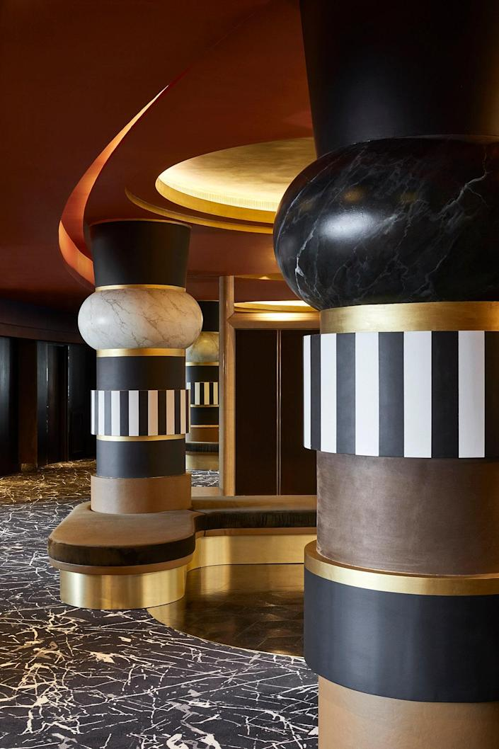 In the lobby of MGallery Nest, the oversized, striped columns are the stars of the show.