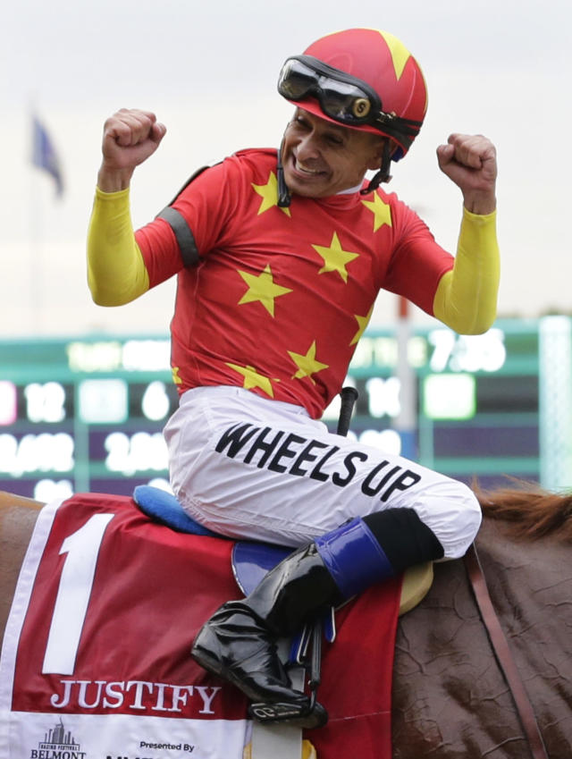 Jockey Mike Smith celebrates after guiding Justify to win the 150th running of the Belmont Stakes horse race and Triple Crown, Saturday, June 9, 2018, in Elmont, N.Y. (AP Photo/Frank Franklin II)