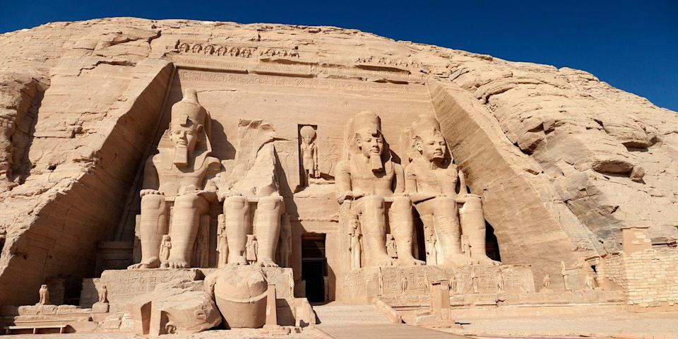 """<p>The <a href=""""https://www.tripadvisor.com/Attraction_Review-g297540-d317826-Reviews-Abu_Simbel_Temple_Complex-Abu_Simbel_Aswan_Governorate_Nile_River_Valley.html"""" rel=""""nofollow noopener"""" target=""""_blank"""" data-ylk=""""slk:Abu Simbel temple complex"""" class=""""link rapid-noclick-resp"""">Abu Simbel temple complex</a>, built on the west bank of the Nile River in southern Egypt, is one of the country's most famous ancient sites. Built by Ramses II, the complex consists of two sandstone temples built into the mountainside, one of which is the impressive Great Temple, which features four intricately carved seated figures on the façade, each of which is 65 feet high. </p>"""
