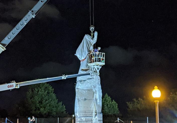A statue of Christopher Columbus at Grant Park in Chicago is removed early on July 24, 2020. / Credit: DEREK R. HENKLE/AFP/Getty Images