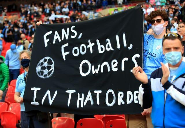 Manchester City fans at Wembley hold up a banner protesting against the European Super League