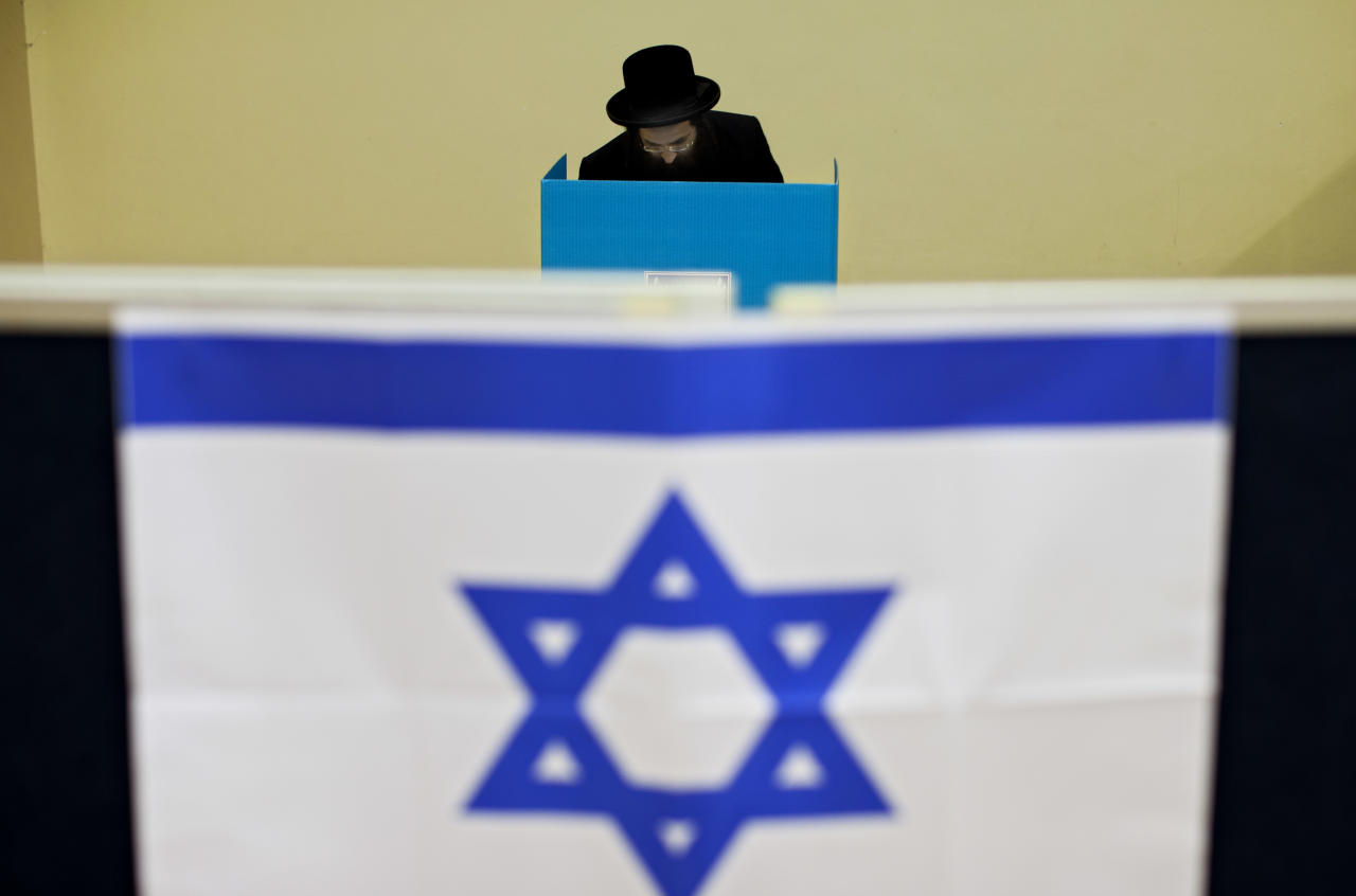 An Ultra-orthodox Jewish man votes in Bnei Brak, Israel, during legislative elections Tuesday, Jan. 22, 2013.  Israelis began trickling into polling stations Tuesday morning to cast their votes in a parliamentary election expected to return Prime Minister Benjamin Netanyahu to office despite years of stalled peacemaking with the Palestinians and mounting economic troubles. Polls indicate about a dozen of 32 parties competing in Tuesday's election have a chance of winning seats in the 120-member parliament. Most parties fall either into the right-wing-religious or center-left camp, and surveys indicate hard-line and ultra-Orthodox Jewish parties will command a majority. (AP Photo/Oded Balilty)