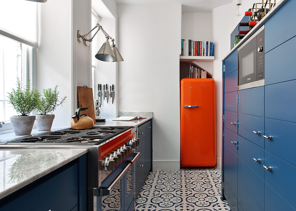 """<p>If a pure white kitchen is too plain or clinical for your taste, use it as your base colour across walls, floors and countertops, and have some fun with pops of colour. Grab your colour wheel to find two complementary colours to add to your base – such as the deep blue and bright orange used here. <a href=""""https://www.housebeautiful.com/uk/decorate/walls/a37022238/instagrammable-paint-colours-summer/"""" rel=""""nofollow noopener"""" target=""""_blank"""" data-ylk=""""slk:Read the Top 10 Instagrammabe paint colours"""" class=""""link rapid-noclick-resp"""">Read the Top 10 Instagrammabe paint colours</a>.</p><p>Pictured: <a href=""""https://www.neptune.com/kitchen/limehouse/"""" rel=""""nofollow noopener"""" target=""""_blank"""" data-ylk=""""slk:Limehouse Kitchen at Neptune"""" class=""""link rapid-noclick-resp"""">Limehouse Kitchen at Neptune</a> </p>"""