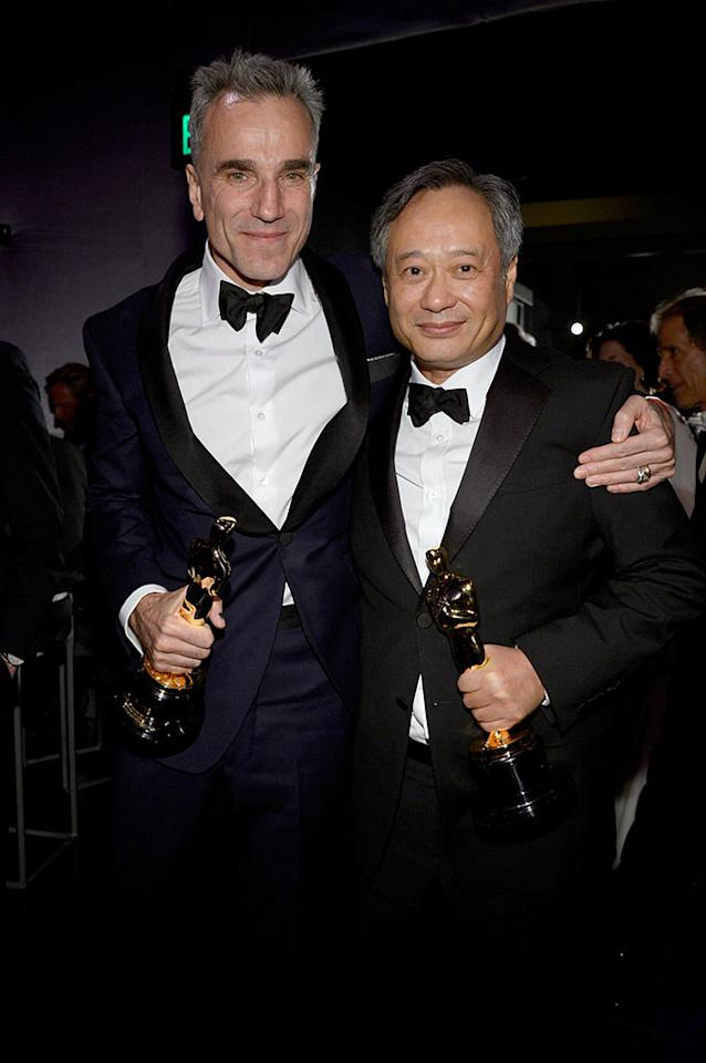 Daniel Day-Lewis holds his trophy for Best Actor for 'Lincoln' and director Ang Lee  holds his Best Director trophy for ' Life of Pi' as they attend the Oscars Governors Ball at Hollywood & Highland Center on February 24, 2013 in Hollywood, California.