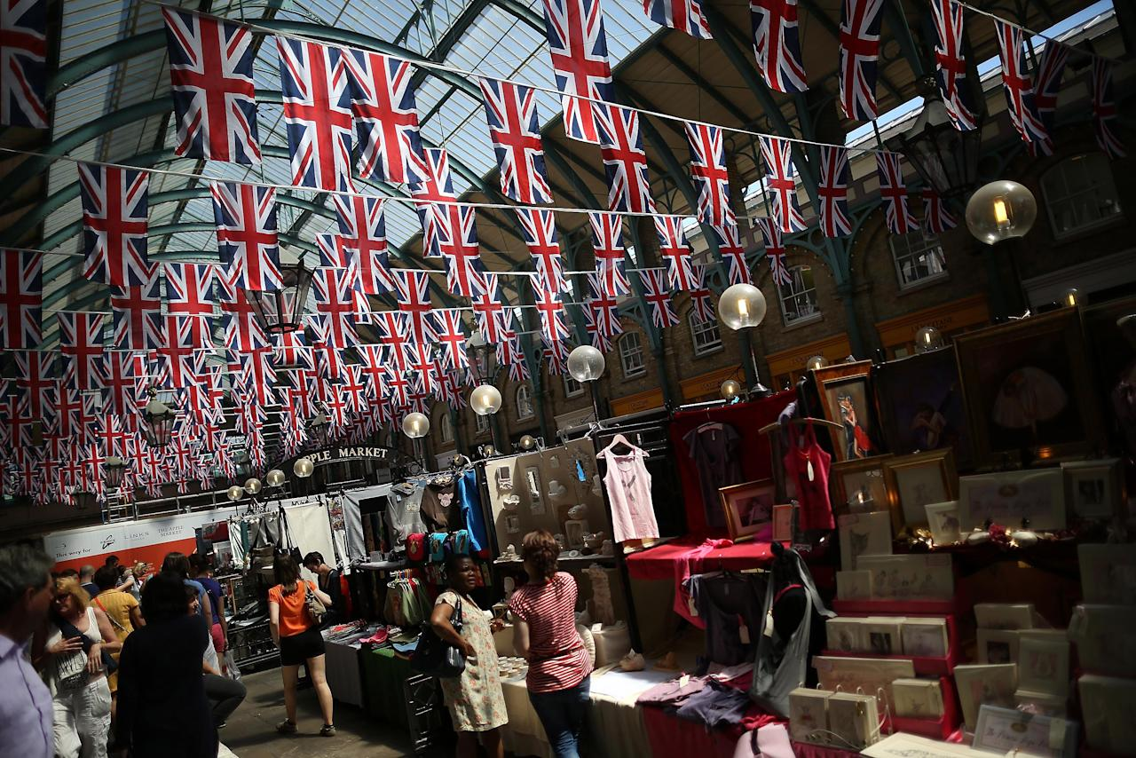LONDON, ENGLAND - MAY 25:  Covent Garden is decorated with Union flags on May 25, 2012 in London, England. The capital is preparing to hold four days of celebrations over the first weekend in June to commemorate Queen Elizabeth II's Diamond Jubilee. (Photo by Peter Macdiarmid/Getty Images)