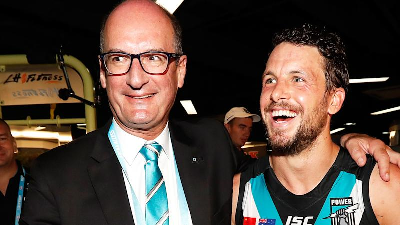 David Koch, pictured here with Port Adelaide captain Travis Boak after a game.