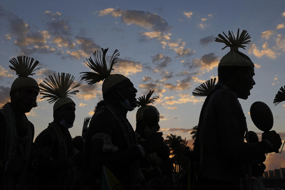 """Indigenous men take part in the """"Luta Pela Vida,"""" or """"Struggle For Life"""" mobilization for Indigenous rights outside the Supreme Court in Brasilia, Brazil, Tuesday, Aug. 24, 2021. Indigenous groups are protesting a Supreme Court ruling that they say could could undermine rights to their lands and the governement of President Jair Bolsonaro'.(AP Photo/Eraldo Peres)"""