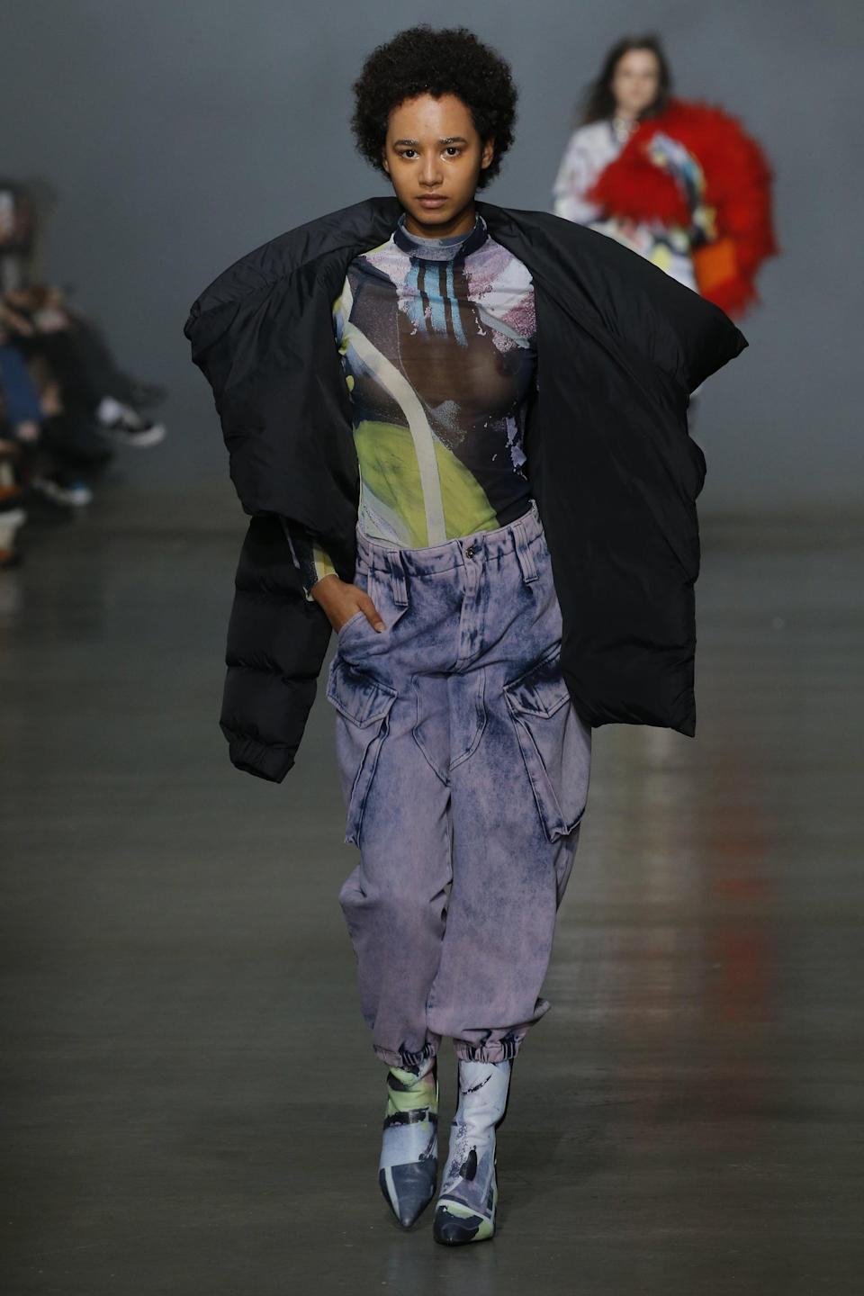 <p>Founded in 2011, Marques'Almeida is one of the younger brands demonstrating what very well may be the future of luxury. A cross between high fashion and streetwear, denim is juxtaposed with delicate fabrics such as silk. To get front row-ready, try a pair of colored acid wash jeans (yep, they're back) and a printed top (literally anything goes here).</p>