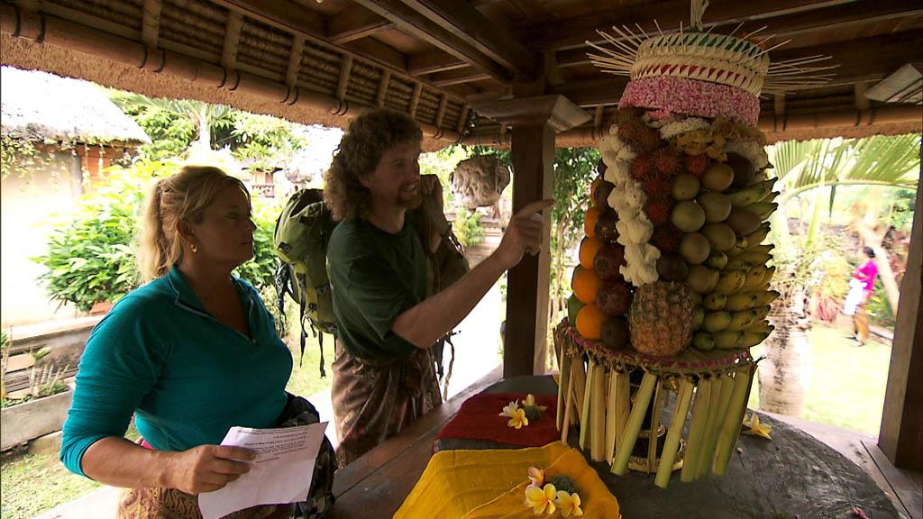 """I Love Monkeys!"" -- In Detour B, Married couple Wynona (left) and Chuck (right) must assemble an elaborate religious offering known as a ""Gebogan"" then take it to the Pura Desa Puseh Temple for a blessing in order to receive the next clue, on ""The Amazing Race."""